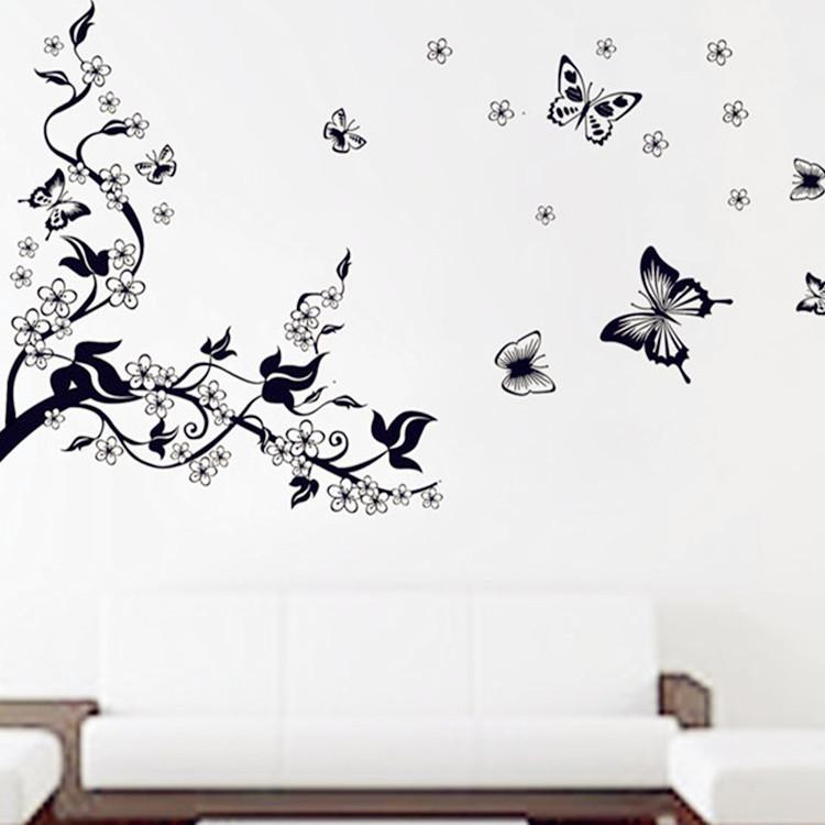 מדבקת קיר ענף עם פרחים ופרפרים